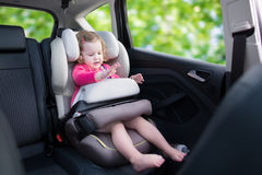 Little girl in car seat Stock Photos