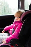 Little girl in a car seat Royalty Free Stock Photos
