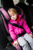 Little girl in a car seat Stock Photos