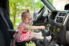 Little girl in the car Royalty Free Stock Photos
