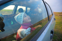 Little girl in the car smiling Royalty Free Stock Images