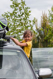 Little girl and car with surfboard Royalty Free Stock Image