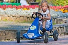 Little girl in the car Stock Photos
