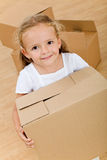 Little girl with cardboard box - closeup Stock Photography