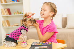 Little girl is caressing her pet. Royalty Free Stock Image