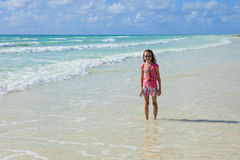 Little girl in the caribbean Stock Images