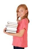Little girl caring books. Stock Photo