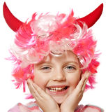 Little girl with carnival or halloween mask. On white background Royalty Free Stock Photo