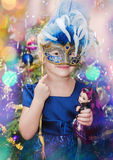 Little girl with a carnival mask Royalty Free Stock Image