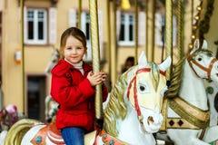 Little girl  on carousel horse. Little girl sitting on carousel horse Royalty Free Stock Photo