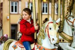 Little girl  on carousel horse. Little girl sitting on carousel horse Stock Image