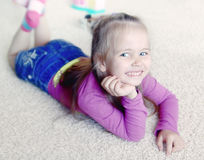 Little girl on a carpet Royalty Free Stock Photo