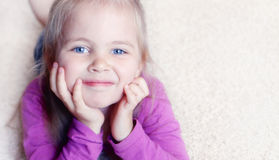 Little girl on a carpet Stock Image
