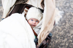 The little girl in a carriage Royalty Free Stock Photos