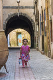 Little girl carries water bottle in Morocco stock images
