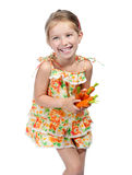 Little girl  with the carrot Royalty Free Stock Photos