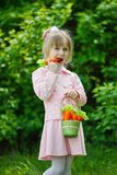 Little girl with carrot stock photos