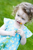 Little girl with a carrot Stock Photo