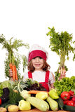 Little girl with carrots and vegetables Stock Photos