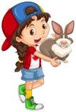 Little girl carrying gray rabbit Stock Images