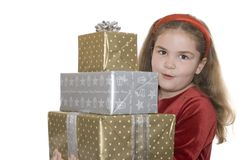 Little girl carrying presents Stock Photos