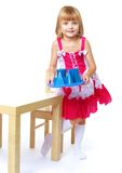 Little girl carrying a tray with cubes Royalty Free Stock Image