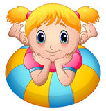 Little girl cartoon lay down above an inflatable ring Royalty Free Stock Photos