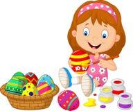 Little girl cartoon painting an Easter egg Stock Image