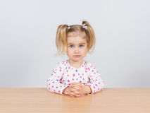 Little girl in casual clothes looking up and thinking Royalty Free Stock Photography