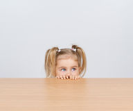 Little girl in casual clothes looking up and thinking Royalty Free Stock Photo