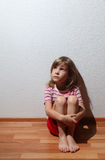 Little girl in casual clothes looks sad to corner Royalty Free Stock Image