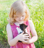 Little girl with cat Stock Photography