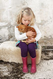 Little girl with cat. A young child hugging a small kitten, very tender moment, lots of love Royalty Free Stock Photos