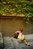 The little girl and a cat. Adorable little girl and a cat outdoors Royalty Free Stock Image
