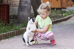 Little girl with cat Royalty Free Stock Photos