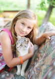 Little girl with cat. Outdoors Stock Photography