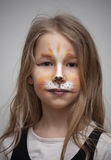 Little girl with cat painting makeup portrait Royalty Free Stock Image