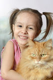 Little girl with a cat Stock Photo