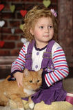 Little girl with cat. Little girl with a red cat Royalty Free Stock Photo