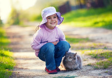 Little girl with cat. Little girl walks with cat outdors Stock Images