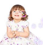 Little girl catches the bubbles Royalty Free Stock Photography
