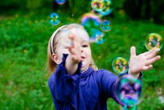 Little girl catching bubbles Royalty Free Stock Photography