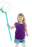 Little girl catching butterflies with a net Royalty Free Stock Photography