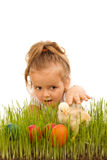 Little girl catching the Easter chicken Royalty Free Stock Photo