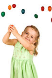 Little girl catching the easter eggs Royalty Free Stock Photography