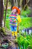 Little girl catching a frog Royalty Free Stock Photo