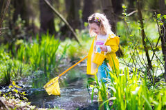 Little girl catching a frog Stock Photography