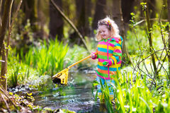 Little girl catching a frog Royalty Free Stock Photos
