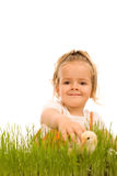Little girl catching the small Easter chicken Royalty Free Stock Photography