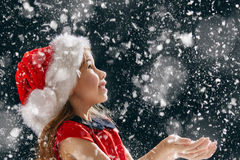 Little girl catching snowflakes Royalty Free Stock Images